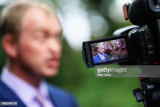 Liberal Democrat leader Tim Farron is interviewed by the media on the campaign trail at the Happy Heart Cafe on May 15 2017 in Solihull England...