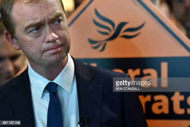 Liberal Democrat leader Tim Farron looks on during a campaign rally with activists and supporters in Kingston upon Thames southwest London on June 1...