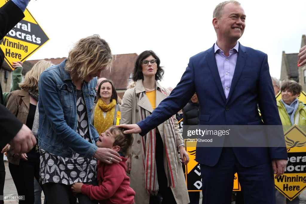Liberal Democrat leader Tim Farron (R) puts his hand on Cillian crying as his mother the Liberal Democrat candidate for the Henley constituency Laura Coyle (L) looks on comforting him while Liberal Democrat candidate for the constituency of Oxford West and Abingdon, Layla Moran (C) stands behind watching at a campaign event on May 3, 2017 in Kidlington, a village outside of Oxford, England. The country goes back to the polls for the second time in two years as a general election is held on June 8.