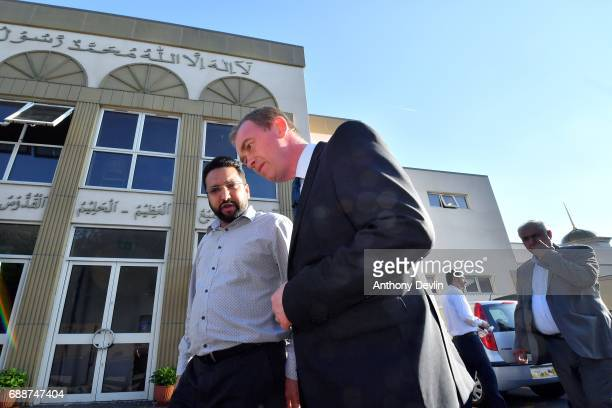 Liberal Democrat Leader Tim Farron speaks to a worshipper following a Remembrance event held by the Ahmadiyya community at the Darul Aman Mosque in...
