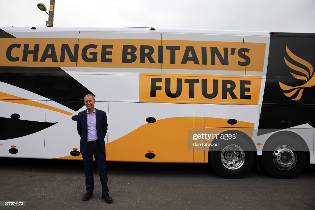 Liberal Democrat leader Tim Farron stands next to the Liberal Democrat 'Battle Bus' after a campaign event on May 3, 2017 in Kidlington, a village outside of Oxford, England. The country goes back to the polls for the second time in two years as a general election is held on June 8.
