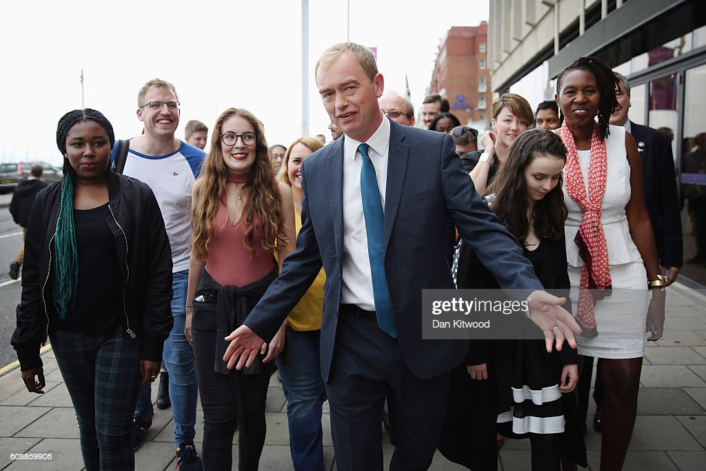 Liberal Democrat leader Tim Farron walks with party members from his hotel to the confrerence centre on the final day of the Liberal Democrat conference on September 20, 2016 in Brighton, England. The party leader Tim Farron will deliver his final speech later today when he will announce that one of his party's key pledges would be to raise taxes to fund shortfalls in the NHS.