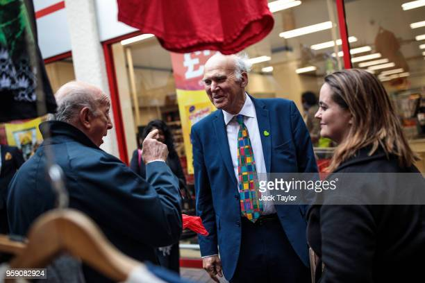 Liberal Democrat Leader Vince Cable and Liberal Democrat Parliamentary candidate for Lewisham East Lucy Salek speak to a Brexitsupporter in Catford...