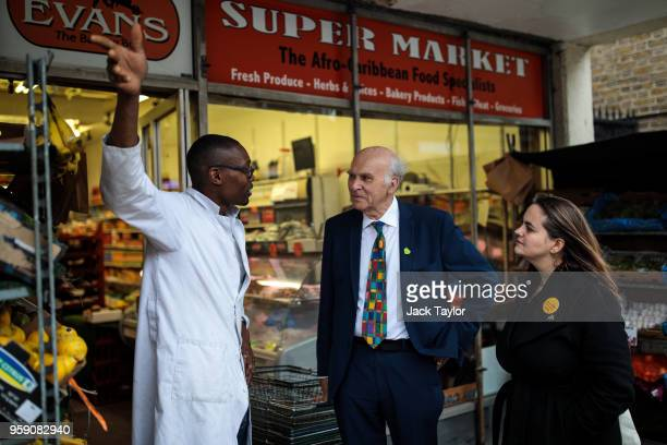 Liberal Democrat Leader Vince Cable and Liberal Democrat Parliamentary candidate for Lewisham East Lucy Salek speak to a shop worker in Catford...