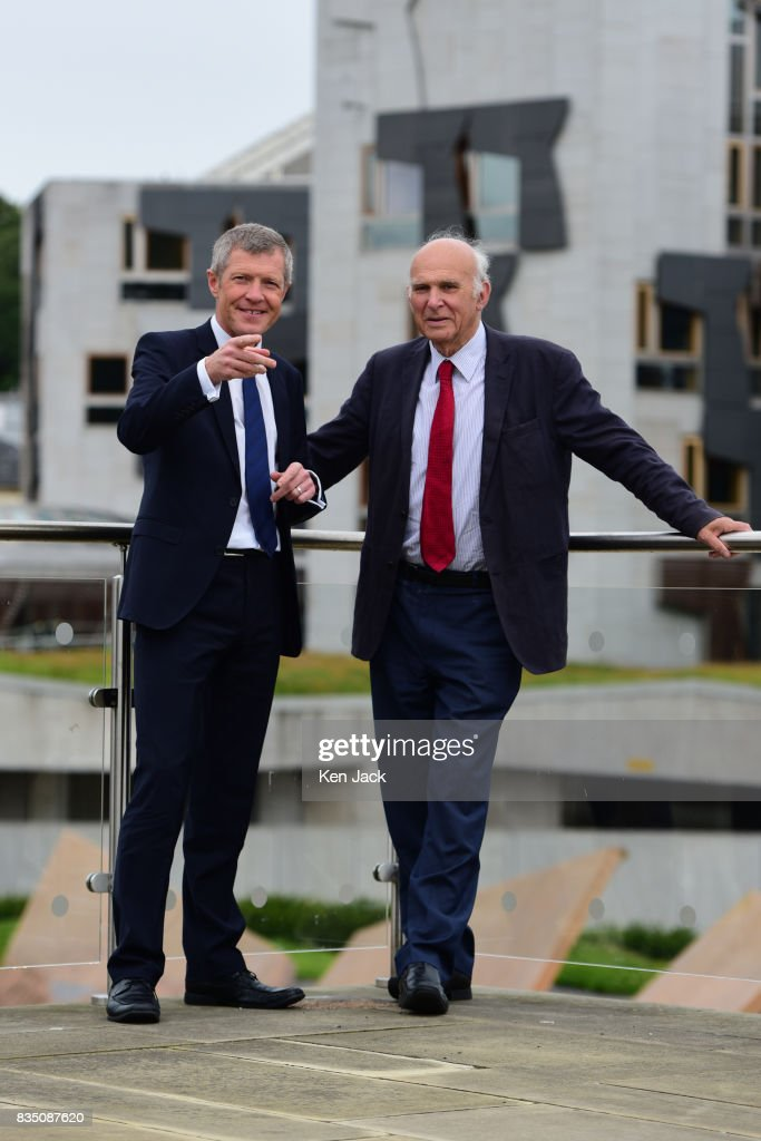 Liberal Democrat leader Vince Cable (R) and Scottish party leader Willie Rennie (L) pose for photographs with the Scottish Parliament in the background ahead of a Scottish Liberal Democrat party event, on August 18, 2017 in Edinburgh, Scotland.