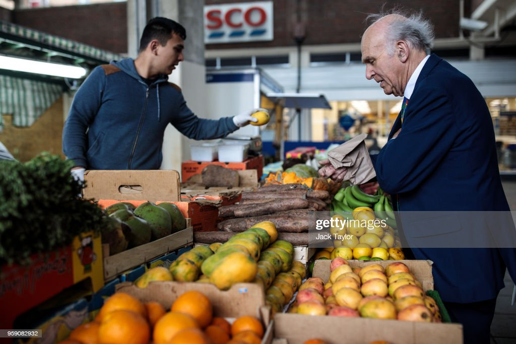 Liberal Democrat Leader Vince Cable buys a mango from a fruit and vegetable stall in Catford Market as the party launch their Lewisham East by-election campaign on May 16, 2018 in London, England. The June 14th by-election for Lewisham East was triggered by the resignation of Heidi Alexander who is to work for London Mayor Sadiq Khan.