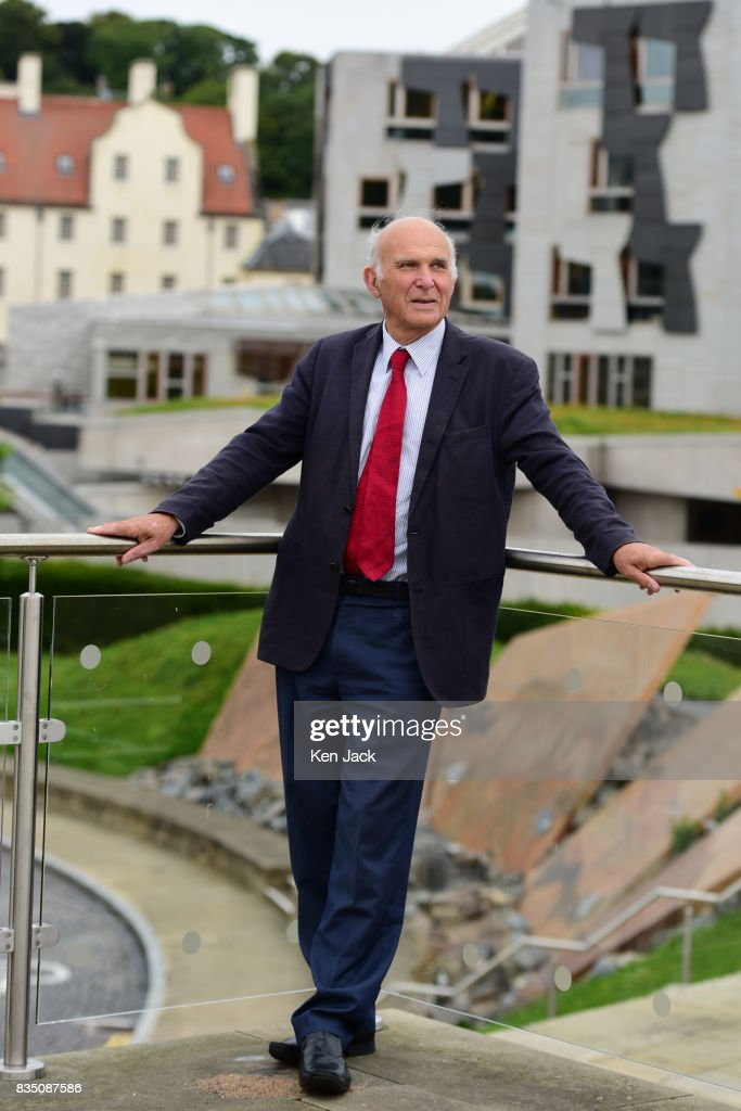 Liberal Democrat leader Vince Cable poses for photographs with the Scottish Parliament in the background ahead of a Scottish Liberal Democrat party event, on August 18, 2017 in Edinburgh, Scotland. Mr Cable was meeting with Scottish Liberal Democrat leader Willie Rennie and other elected members.