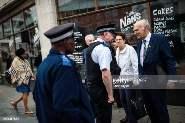 Liberal Democrat Leader Vince Cable speaks to a police community support officer in Catford as the party launch their Lewisham East byelection...