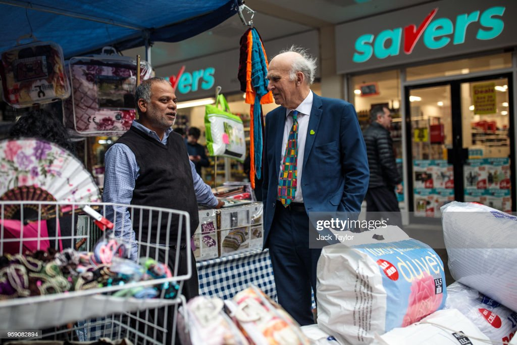 Liberal Democrat Leader Vince Cable speaks to a stall owner in Catford Market as the party launch their Lewisham East by-election campaign on May 16, 2018 in London, England. The June 14th by-election for Lewisham East was triggered by the resignation of Heidi Alexander who is to work for London Mayor Sadiq Khan.