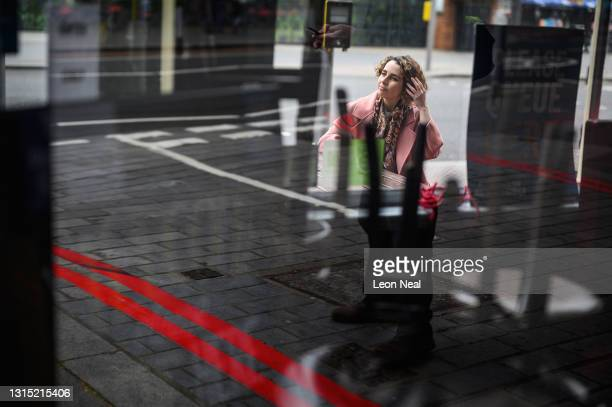 Liberal Democrat Mayoral Candidate Luisa Porritt is seen through the window of a closed pub as she campaigns in Bermondsey on April 29, 2021 in...