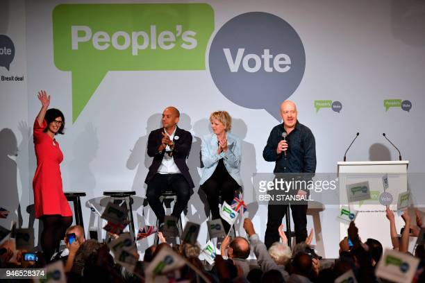 Liberal Democrat MP Layla Moran waves as she joins Labour Party MP Chuka Umunna Conservative MP Anna Soubry and comedian Andy Parsons on stage during...