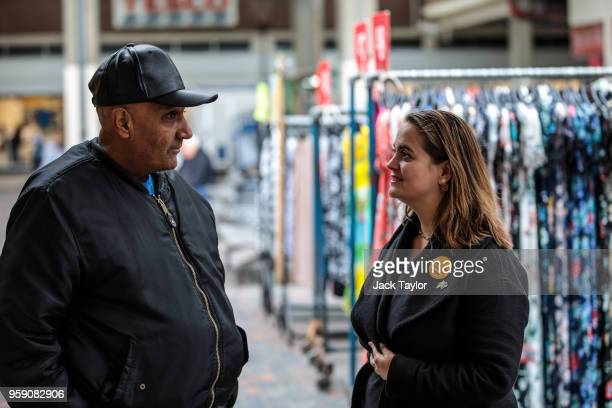 Liberal Democrat Parliamentary candidate for Lewisham East Lucy Salek speaks to a man in Catford Market as the party launch their Lewisham East...