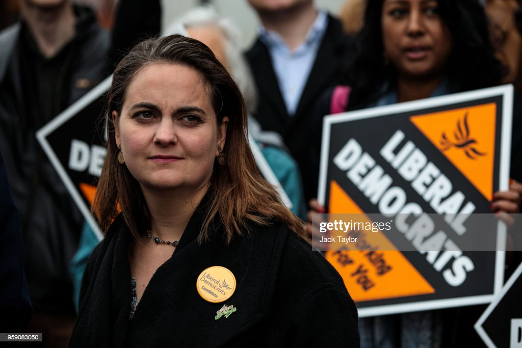 Liberal Democrat Parliamentary candidate for Lewisham East, Lucy Salek stands in front of campaigners holding Liberal Democrat signs outside Catford Market as the party launch their Lewisham East by-election campaign on May 16, 2018 in London, England. The June 14th by-election for Lewisham East was triggered by the resignation of Heidi Alexander who is to work for London Mayor Sadiq Khan.