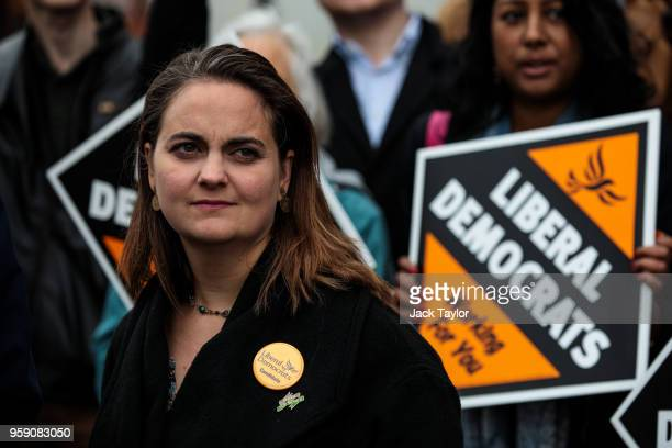 Liberal Democrat Parliamentary candidate for Lewisham East Lucy Salek stands in front of campaigners holding Liberal Democrat signs outside Catford...