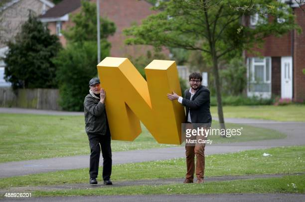 Liberal Democrat party activists walk with a giant letter to be used for a photocall as they canvas for potential votes on the streets of Newbury...