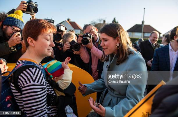 Liberal Democrat party leader Jo Swinson meets Elizabeth Brown 9 months old as she greets activists during a rally on December 11 2019 in Esher...