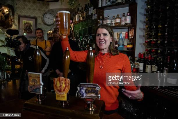 Liberal Democrat party leader Jo Swinson pours a pint of beer in Dylans The Kings Arms whilst campaigning for the general election on December 7 2019...
