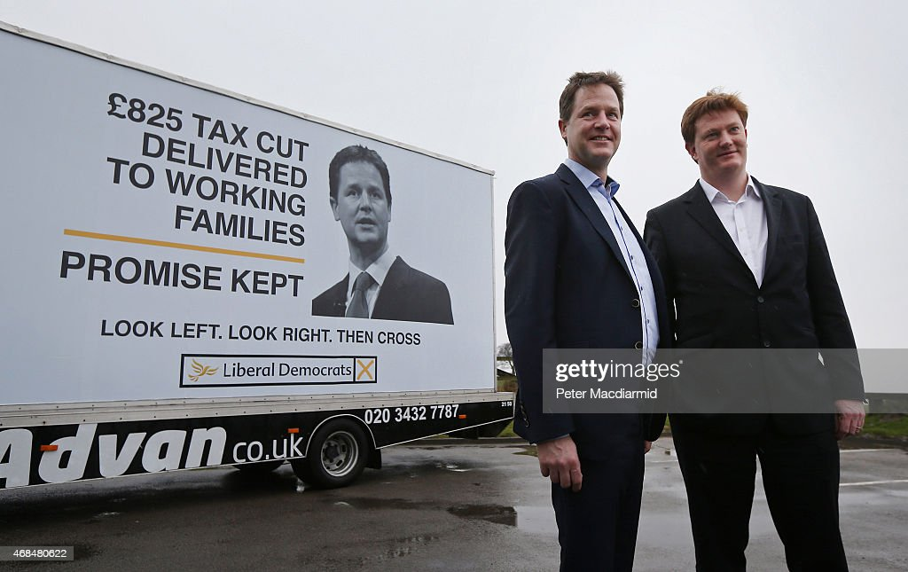 Liberal Democrat party leader Nick Clegg (L) stands with Danny Alexander at a poster launch event in Hyde on April 3, 2015 near Manchester, England. General election campaigning has resumed after party leaders took part in a televised debate last night in Manchester.