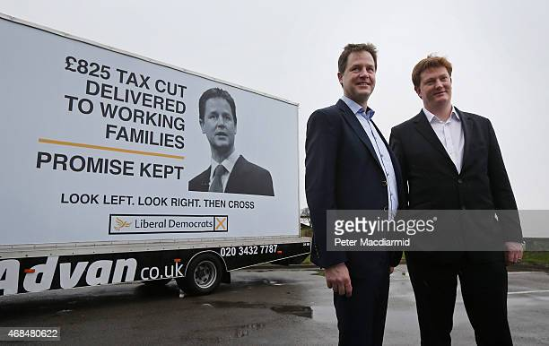 Liberal Democrat party leader Nick Clegg stands with Danny Alexander at a poster launch event in Hyde on April 3, 2015 near Manchester, England....