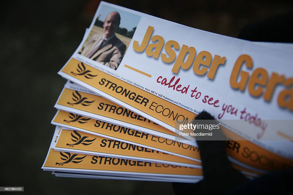 A Liberal Democrat party workers carries leaflets as she helps candidate Jasper Gerard canvass for votes in the Maidstone and the Weald constituency on January 26, 2015 in Maidstone, England. Campaigning for the May 7th general election is well under way with just over 100 days to go to polling day.