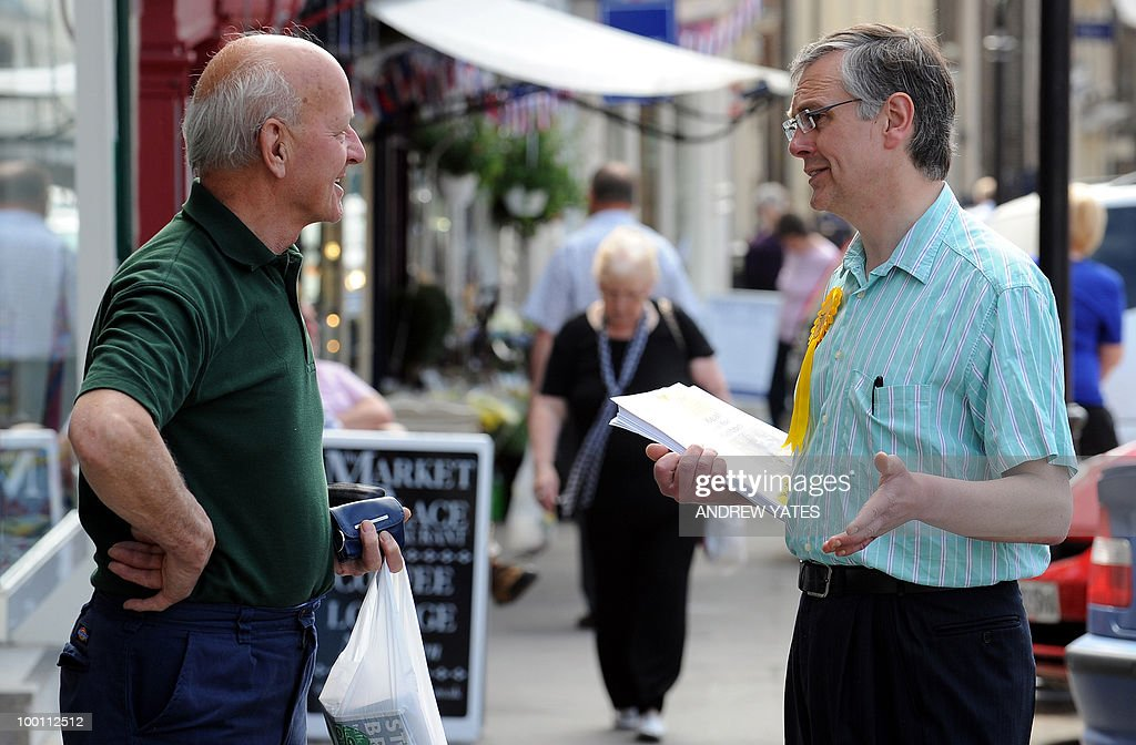 Liberal Democrat party's prospective MP for Thirsk and Malton, Howard Keal (R), canvasses for votes in the market square in Malton, north Yorkshire, England on May 21, 2010. Keal will stand against Conservative candidate Anne McIntosh for the Thirsk and Malton constituency seat, voting for which will take place on May 27, 2010.