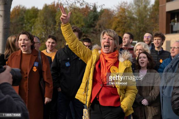 Liberal Democrat supporters cheer as leader Jo Swinson and Layla Moran the Liberal Democrat candidate for Oxford West and Abingdon visit Trumpington...