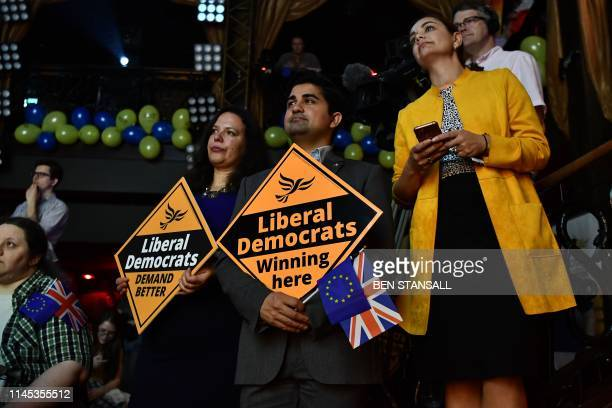 Liberal Democrat supporters hold signs during a European Parliament election campaign rally in London on May 21 2019