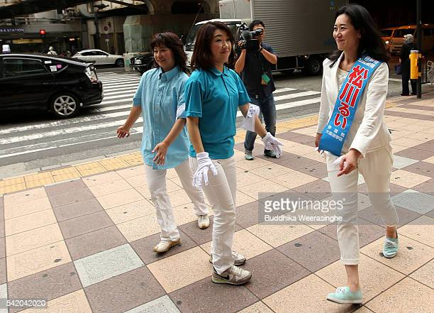 Liberal Democratic Party candidate Rui Matsukawa speaks to voters during her election campaign for the upcoming upper house election on June 22 2016...