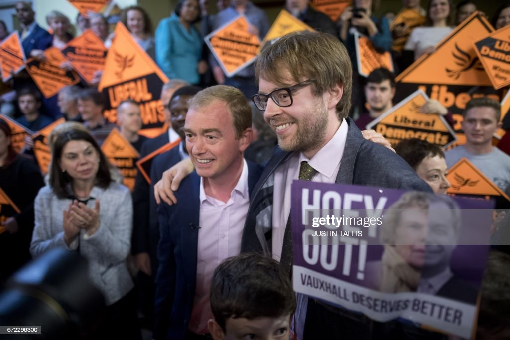 Liberal Democratic Party leader, Tim Farron (centre left) and prospective parliamentary candidate, George Turner (centre right) pose together for members of the media after a campaign event in London on April 24, 2017, in the build-up to the general election on June 8th. Tim Farron, whose centre-left party holds just nine seats, hopes to make gains in the surprise election in June. / AFP PHOTO / Justin TALLIS