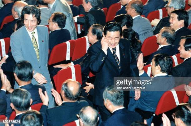 Liberal Democratic Party new president Ryutaro Hashimoto and defeated candidate Junichiro Koizumi leave after the LDP presidential election at the...