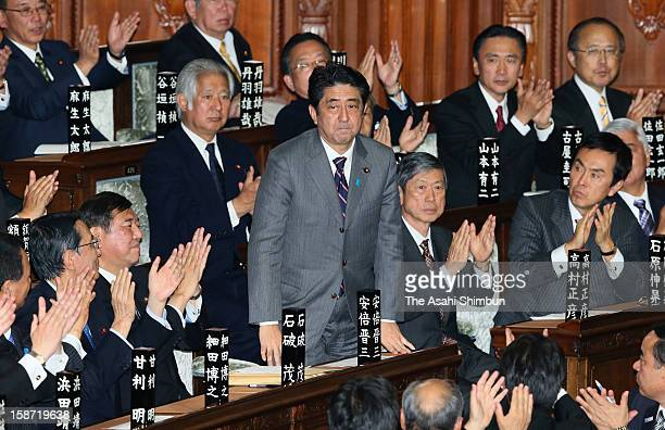 Liberal Democratic Party president Shinzo Abe is applaunded by fellow lawmakers after being elected at the lower house at the diet building on...