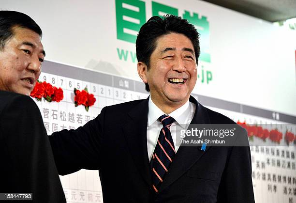 Liberal Democratic Party president Shinzo Abe smiles at their headquarters on December 16 2012 in Tokyo Japan The LDP and coalition New Komeito...