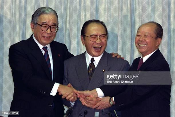 Liberal Democratic Party presidential candidates Hiroshi Mitsuzuka Michio Watanabe and Kiichi Miyazawa shake hands after their joint press conference...