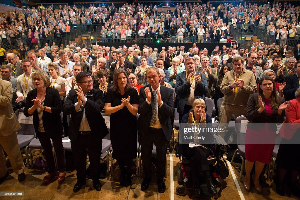 Liberal Democrats join Sarah Gurling (C-L) as they applaud at the end of a special tribute to ex-leader Charles Kennedy on the fourth day of the Liberal Democrats annual conference on September 22, 2015 in Bournemouth, England. The Liberal Democrats are currently holding their annual conference using the hashtag #LibDemfightback in Bournemouth. The conference is the first since the party lost all but eight of its MPs in May's UK general election, however after gaining 20,000 new members since May the party is expecting a record attendance at the event being held at the Bournemouth International Centre.