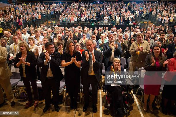 Liberal Democrats join Sarah Gurling as they applaud at the end of a special tribute to exleader Charles Kennedy on the fourth day of the Liberal...