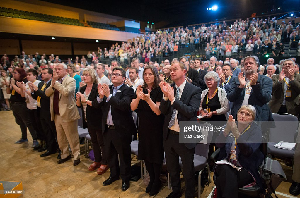 Liberal Democrats join Sarah Gurling (C) as they applaud at the end of a special tribute to ex-leader Charles Kennedy on the fourth day of the Liberal Democrats annual conference on September 22, 2015 in Bournemouth, England. The Liberal Democrats are currently holding their annual conference using the hashtag #LibDemfightback in Bournemouth. The conference is the first since the party lost all but eight of its MPs in May's UK general election, however after gaining 20,000 new members since May the party is expecting a record attendance at the event being held at the Bournemouth International Centre.