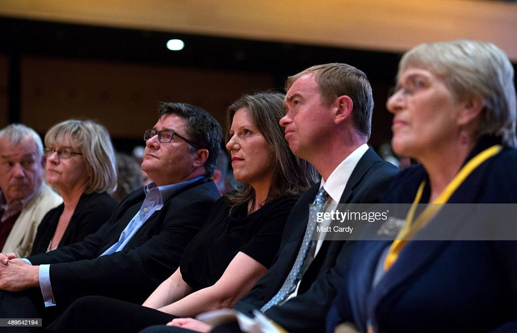 Liberal Democrats join Sarah Gurling (C) as they attend a special tribute to ex-leader Charles Kennedy on the fourth day of the Liberal Democrats annual conference on September 22, 2015 in Bournemouth, England. The Liberal Democrats are currently holding their annual conference using the hashtag #LibDemfightback in Bournemouth. The conference is the first since the party lost all but eight of its MPs in May's UK general election, however after gaining 20,000 new members since May the party is expecting a record attendance at the event being held at the Bournemouth International Centre.