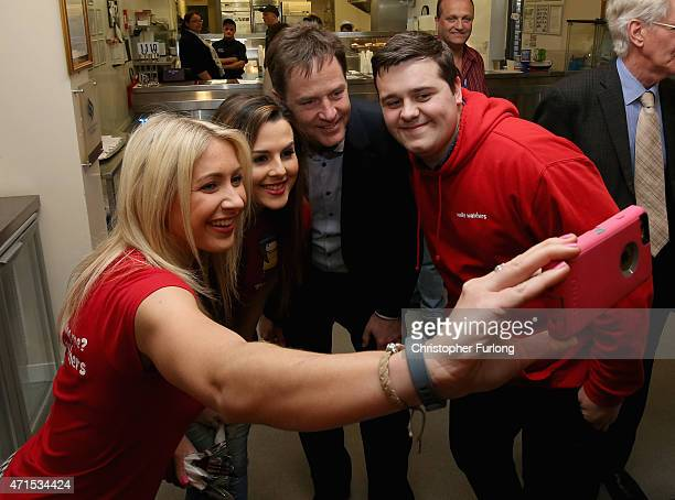 Liberal Democrats leader and Deputy Prime Minister Nick Clegg poses for a selfie in the fish and chip shop with staff from the Startpoint Community...
