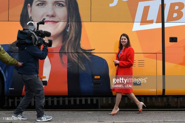 Liberal Democrats leader Jo Swinson poses for the media beside the Battle Bus in north west London on November 6 during their general election...