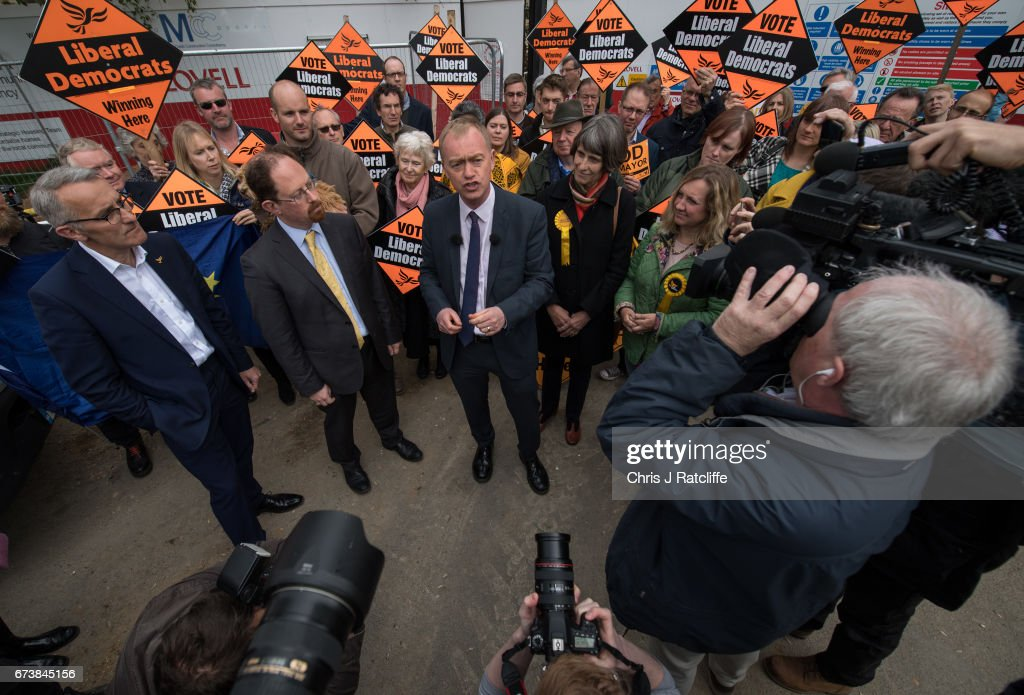 Liberal Democrats leader Tim Farron is seen beside Julian Huppert (to his left) and Susan Van De Ven (to his right) whilst campaigning for the British general election at Eastfield regeneration site on April 27, 2017 in Cambridge, England. Mr Farron has been campaigning in the Cambridgshire area alongside parliamentary candidate and former MP Julian Huppert, Mayoral candidate Rod Cantrill and cadidate for South Cambridgeshire Susan Van De Ven.