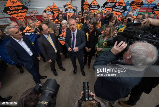 Liberal Democrats leader Tim Farron is seen beside Julian Huppert and Susan Van De Ven whilst campaigning for the British general election at...