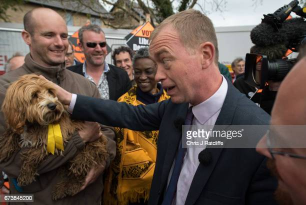 Liberal Democrats leader Tim Farron pets cockapoo dog 'Bonnie' whilst campaigning for the British general election at Eastfield regeneration site on...