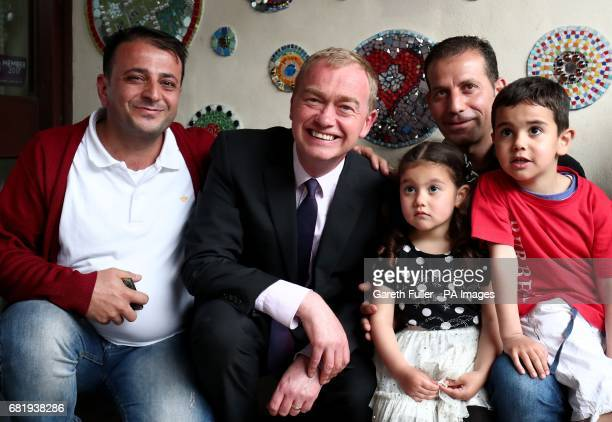 Liberal Democrats leader Tim Farron posse for a photograph with a refugee family from Syria during a visit to charity Gloustershire Action for...