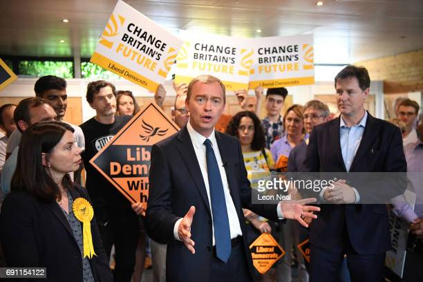 Liberal Democrats leader Tim Farron speaks as Nick Clegg MP looks on during a rally at the Shiraz Mirza Community Hall on June 1 2017 in Kingston...