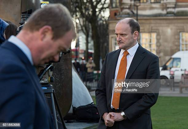 Liberal Democrats party leader Tim Farron and the first elected member of Parliament for UKIP Douglas Carswell speak to the press on College Green...