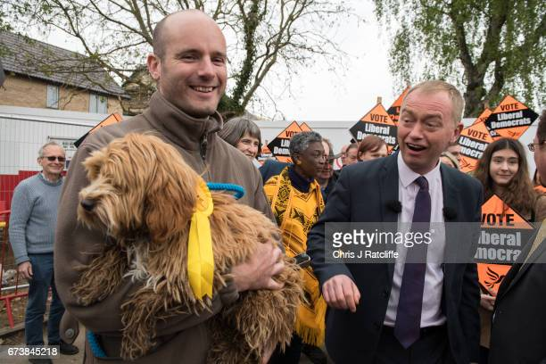 Liberal Democrats party leader Tim Farron walks over to pet cockapoo dog 'Bonnie' as he is campaigning for the British general election at Eastfield...