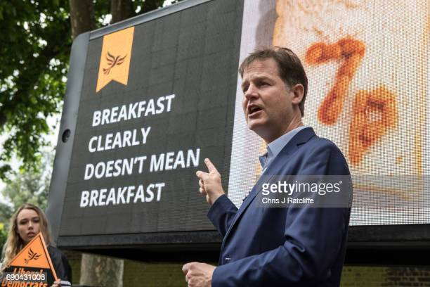 Liberal Democrats Party politician Nick Clegg speaks to the media and supporters whilst unveiling a poster attacking British Prime Minister Theresa...