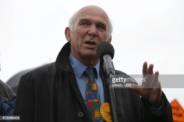 Liberal Democrats politician Vince Cable speaks at the start of Britain's Liberal Democrats leader Tim Farron's battle bus tour in Kingston south...