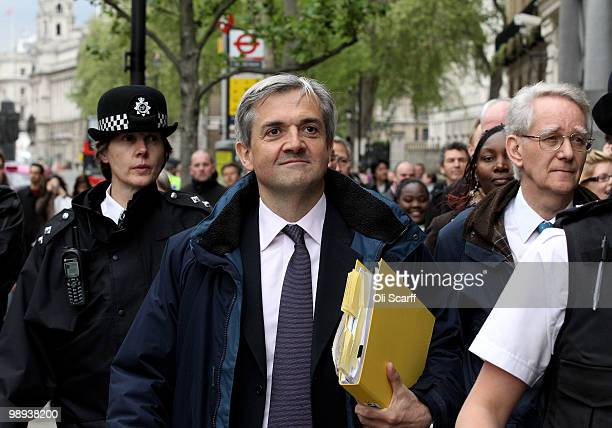 Liberal Democrats Shadow Home Secretary Chris Huhne leaves the Cabinet Office following talks with a team of senior figures from the Conservatives...