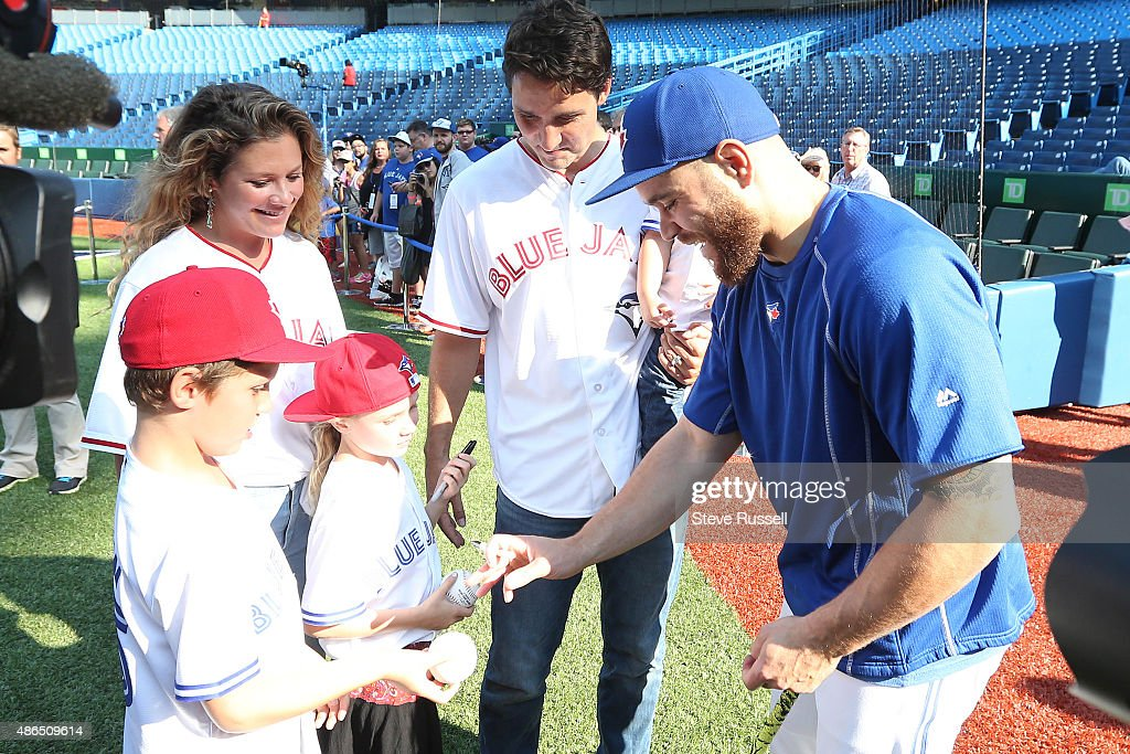 TORONTO, ON- SEPTEMBER 4 - Liberal Leader Justin Trudeau, holding his son Hadrien, and with his wife Sophie and children Xavier and Ella-Grace get an autograph from Toronto Blue Jays catcher Russell Martin as the Toronto Blue Jays play the Baltimore Orioles at the Rogers Centre in Toronto. September 4, 2015.